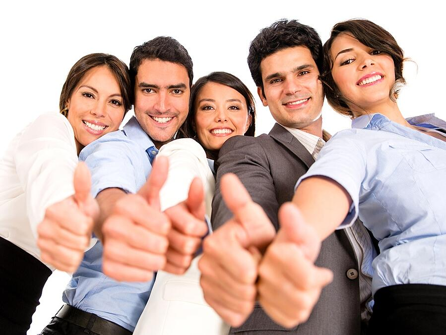 Happy business team with thumbs up - isolated over a white background